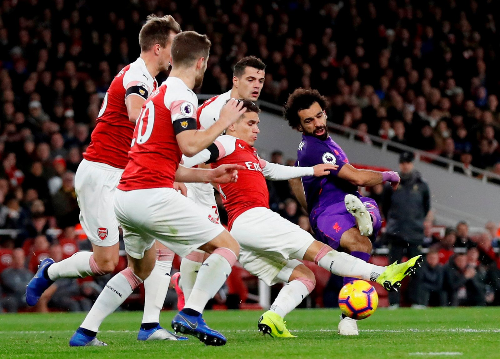 Liverpool's Mohamed Salah closed down by Arsenal's Granit Xhaka, Lucas Torreira, Rob Holding and Shkodran Mustafi
