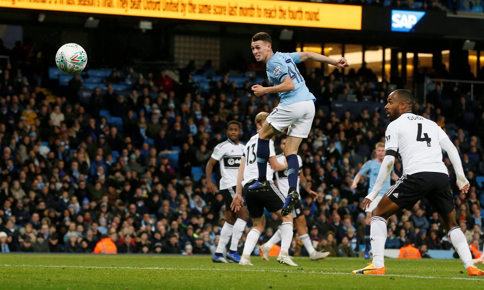 Manchester City's Phil Foden heads at goal vs Fulham in Carabao Cup