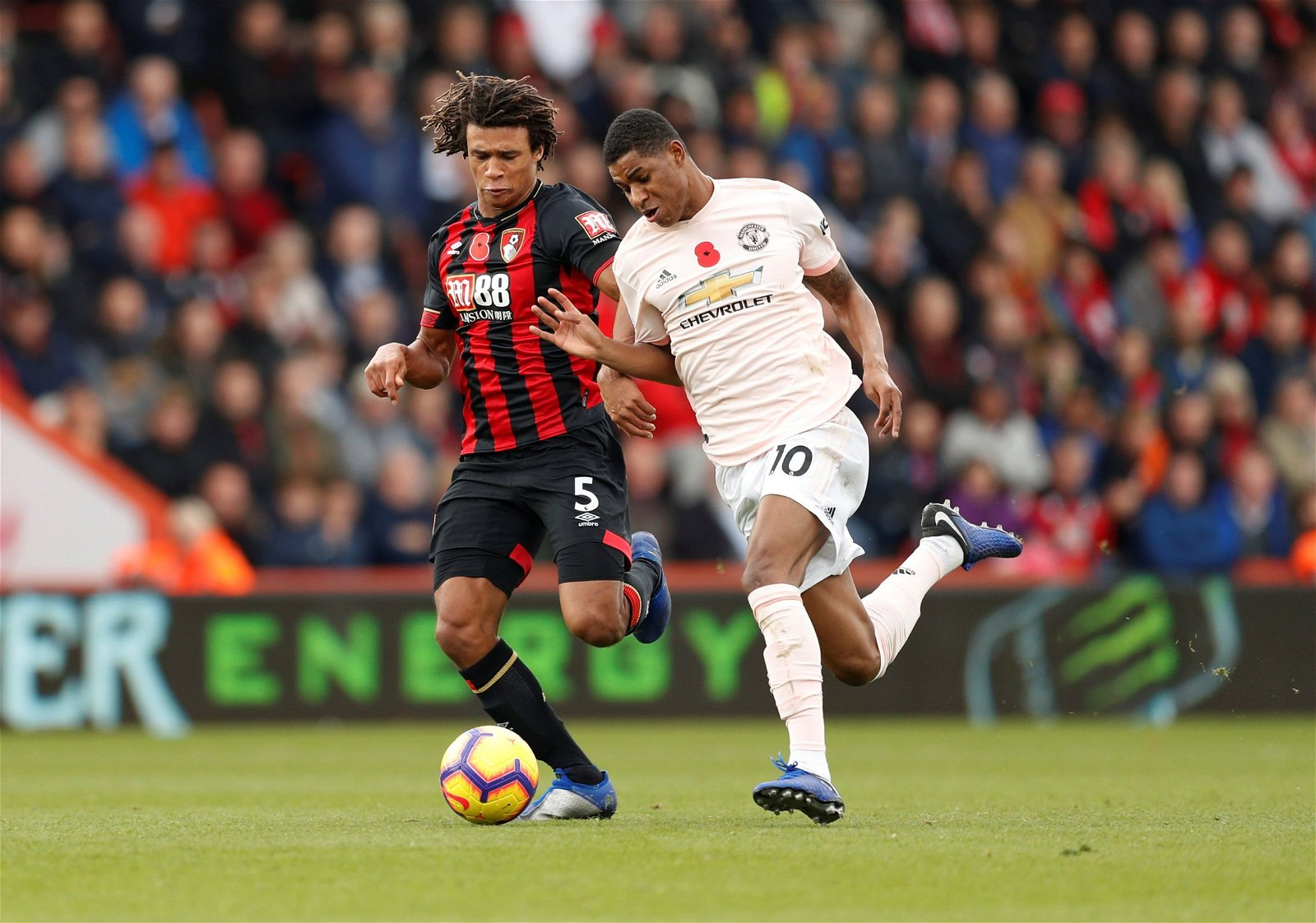 Nathan Ake in action against Man United