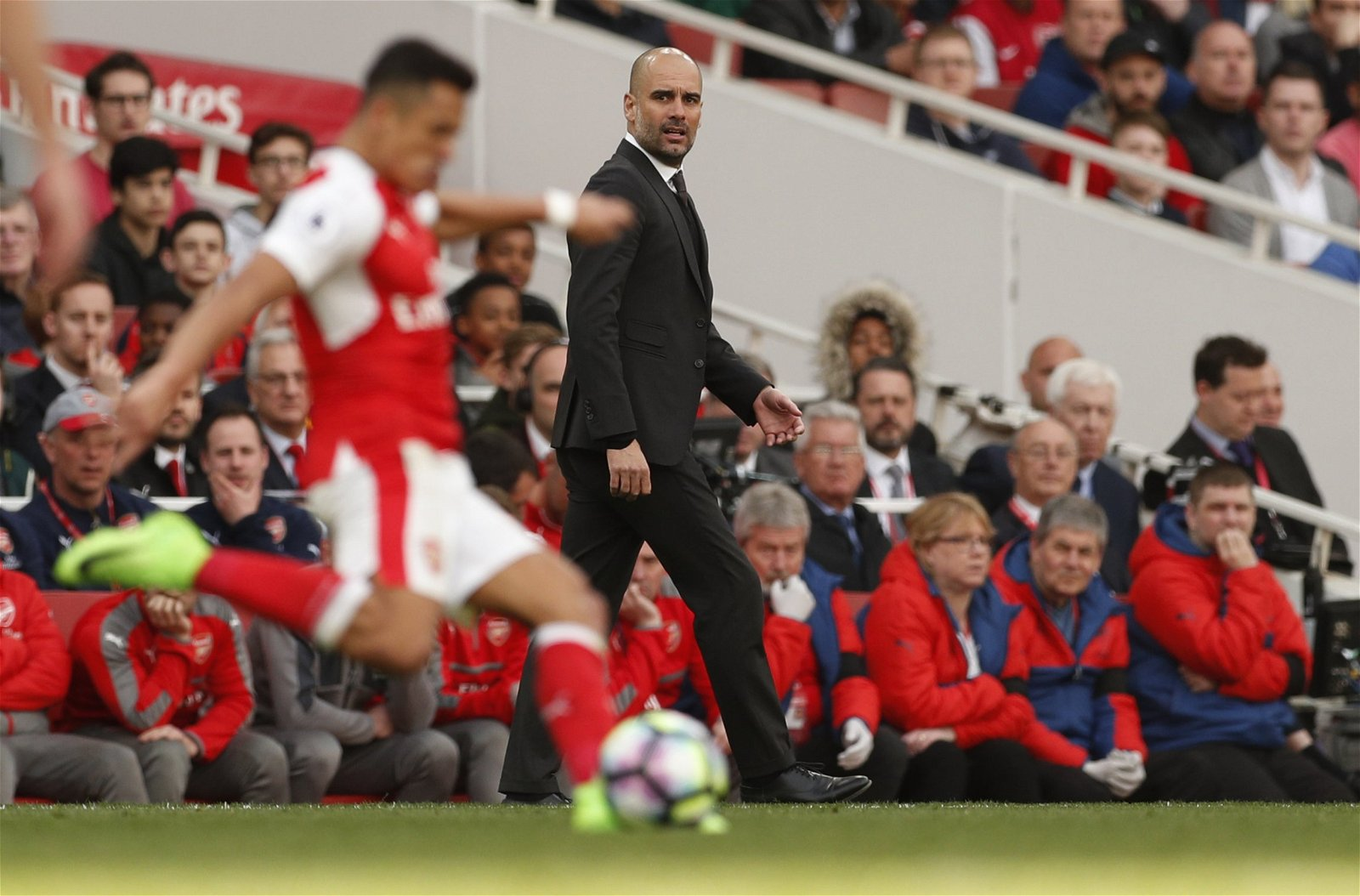 Pep Guardiola watches Alexis Sanchez