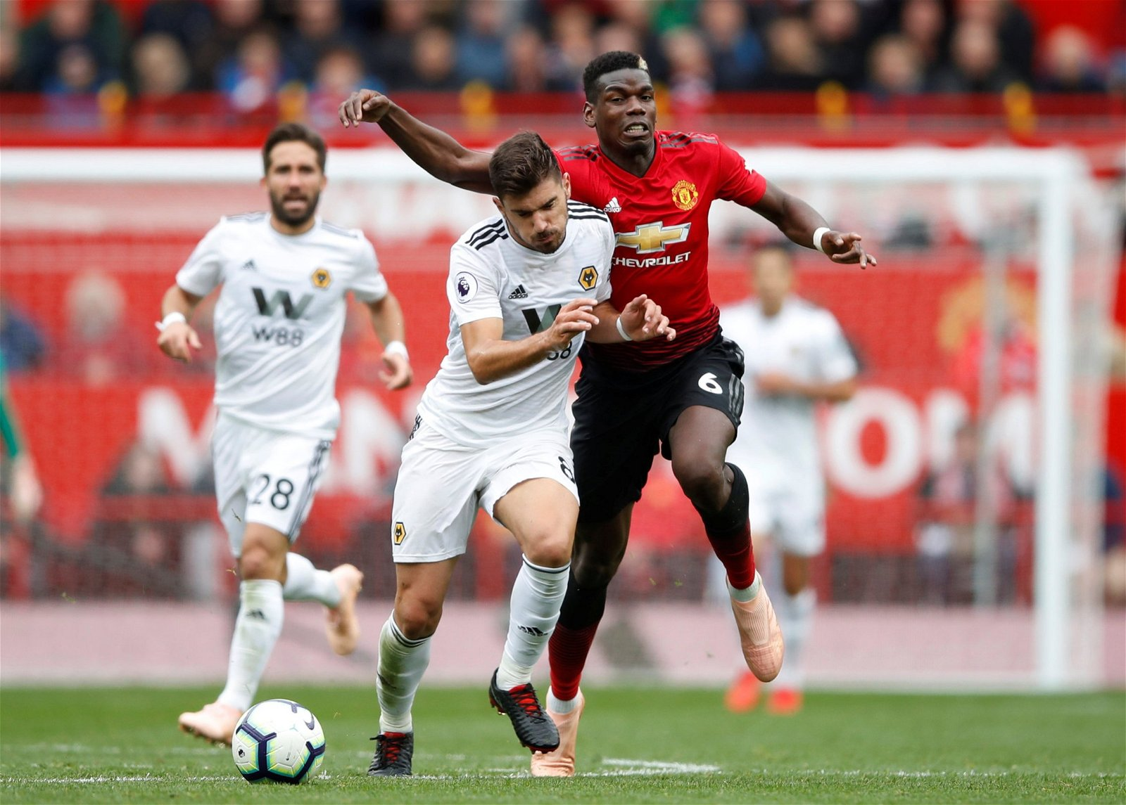 Wolverhampton Wanderers' Ruben Neves slams Manchester United's Paul Pogba to the side