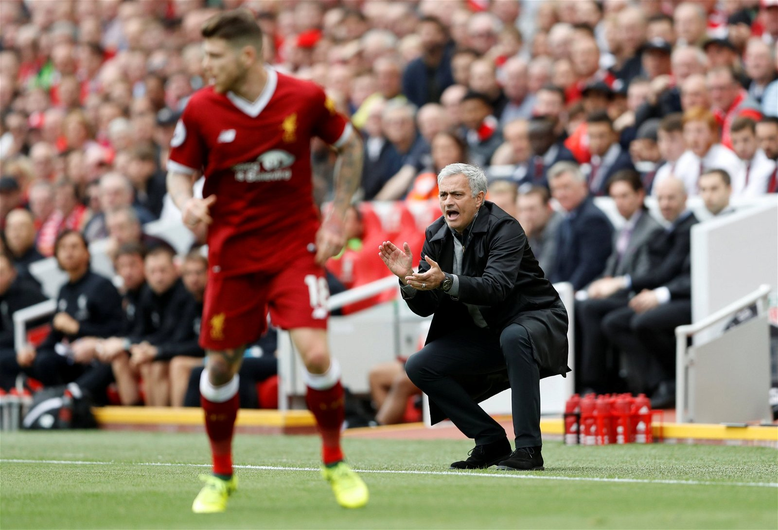 Jose Mourinho encourages his side at Anfield