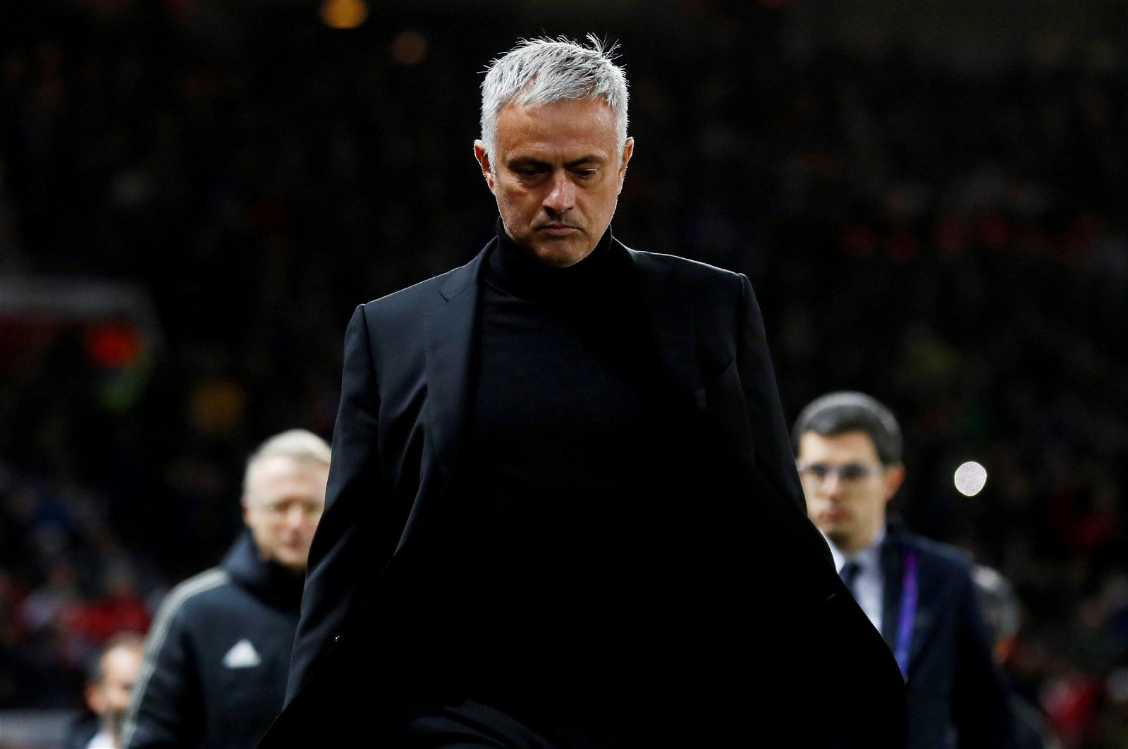 Jose Mourinho looks down