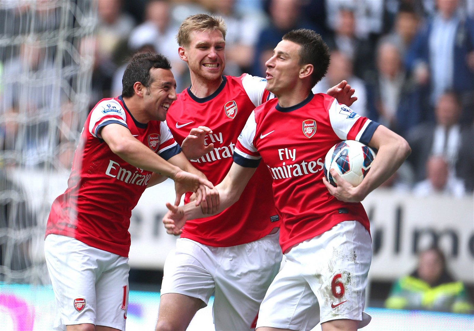 Laurent Koscielny celebrates scoring Arsenal's goal vs Newcastle with Santi Cazorla and Per Mertesacker