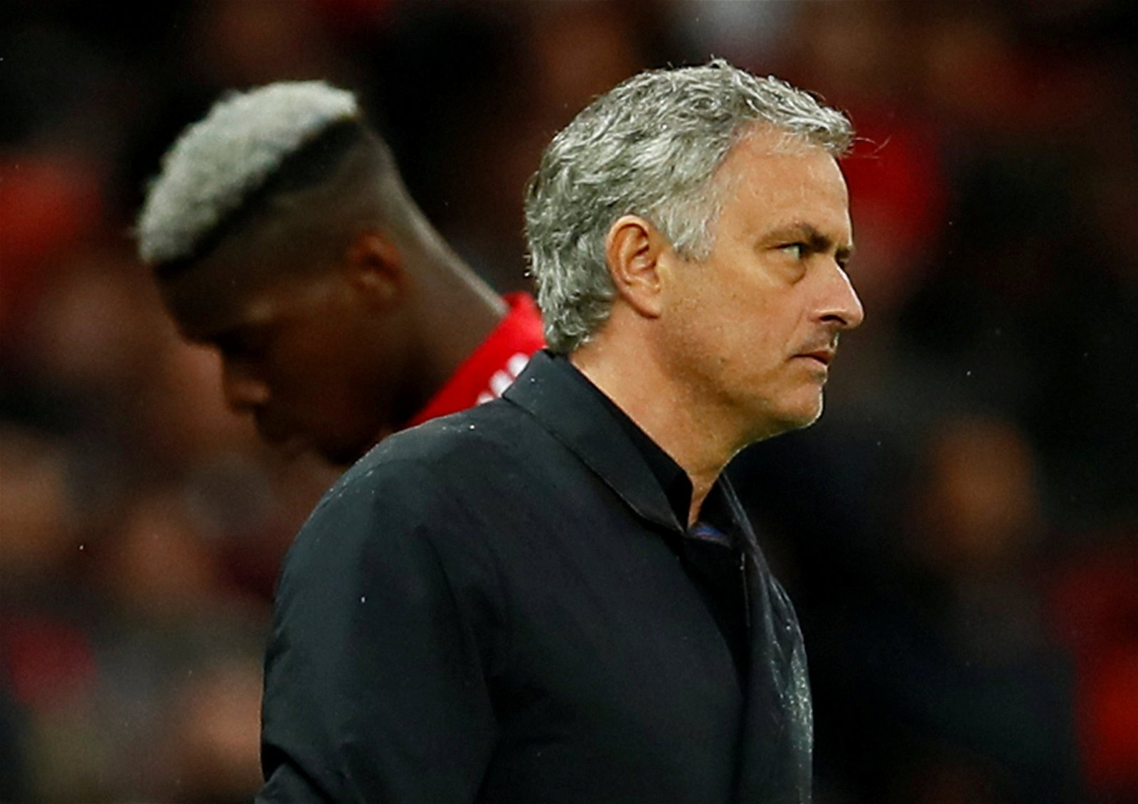 Paul Pogba strides past Manchester United manager Jose Mourinho as he is substituted