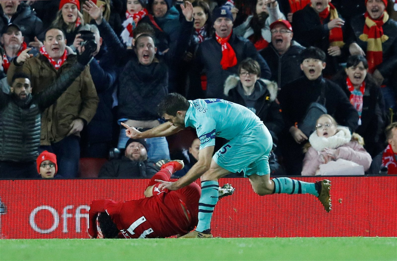 Liverpool's Mohamed Salah is fouled by Arsenal's Sokratis Papastathopoulos
