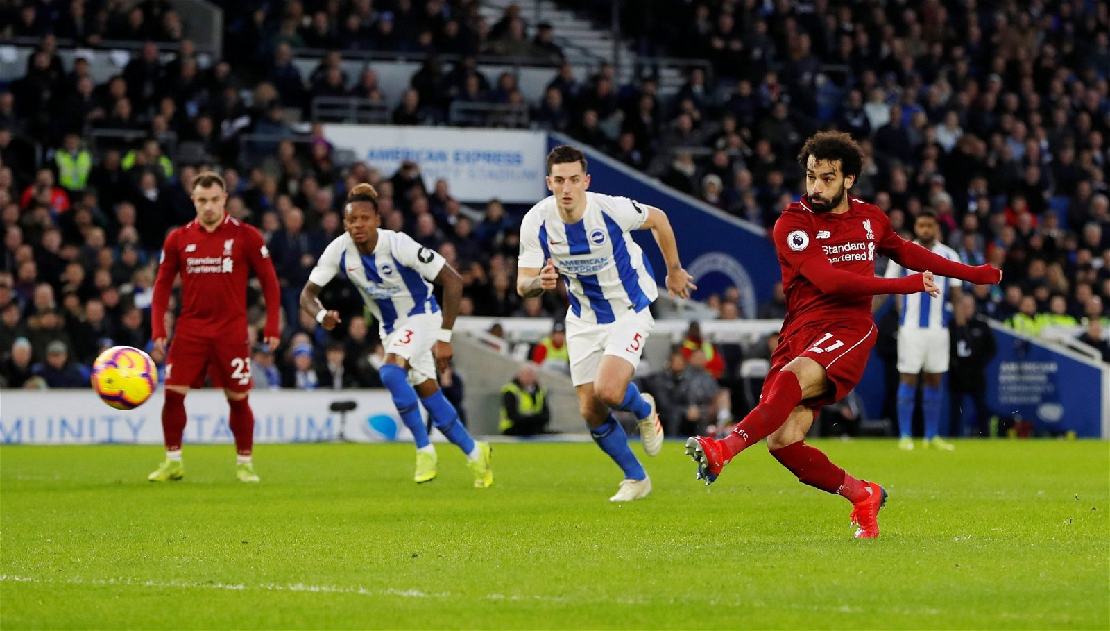 Liverpool's Mohamed Salah scores their first goal from the penalty spot v Brighton