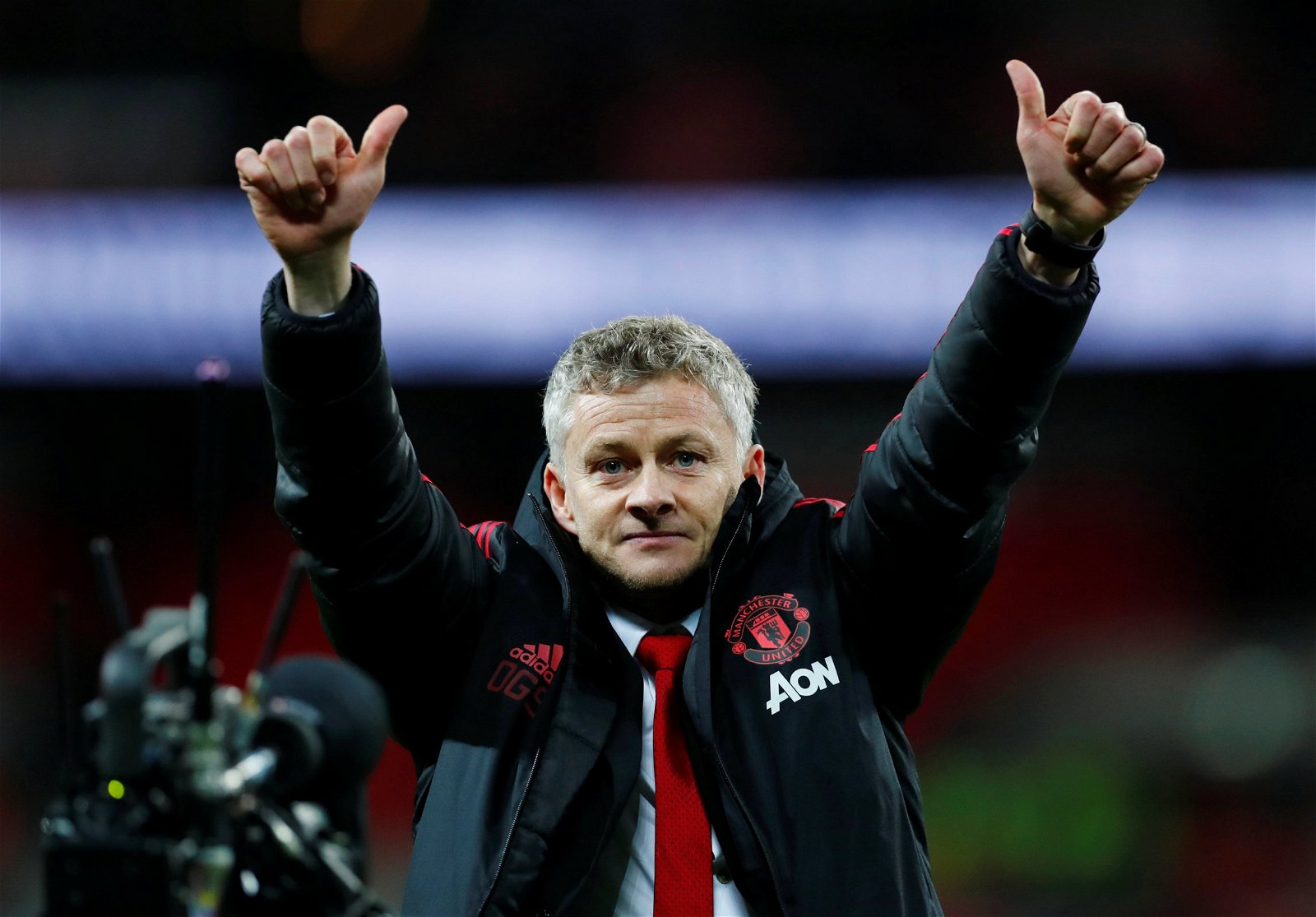Ole Gunnar Solskjaer with his thumbs up to Manchester United fan