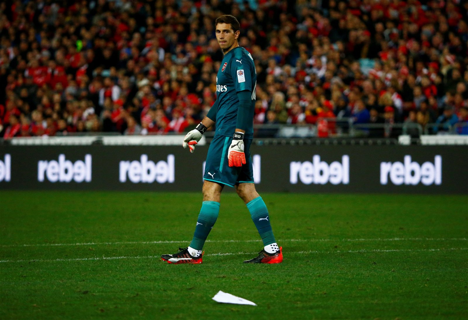 Arsenal's Emiliano Martinez and a paper plane on the pitch in pre-season friendly v Western Sydney Wanderers