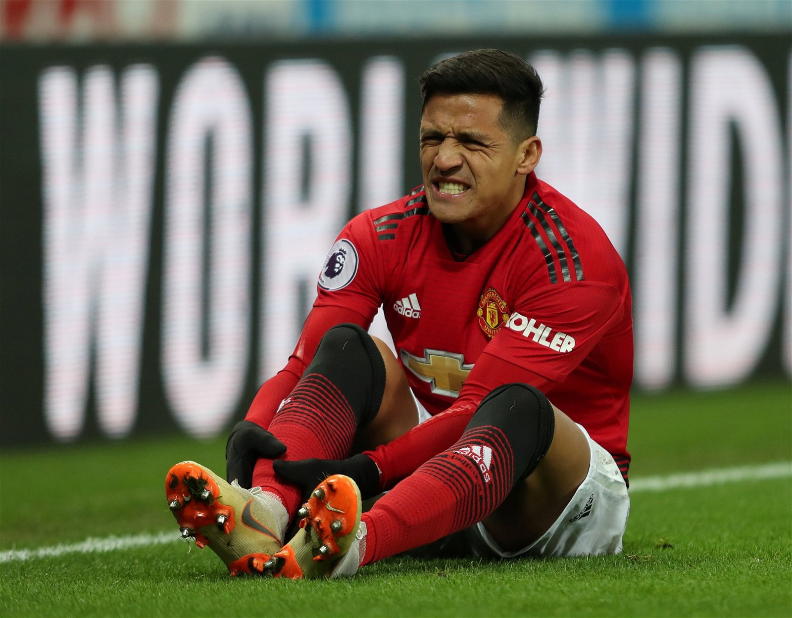 Alexis Sanchez looks in pain