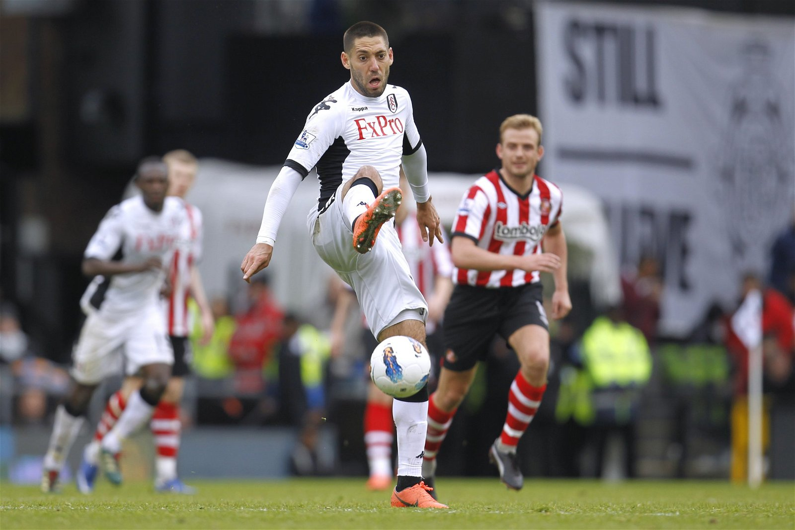Fulham's Clint Dempsey controls the ball