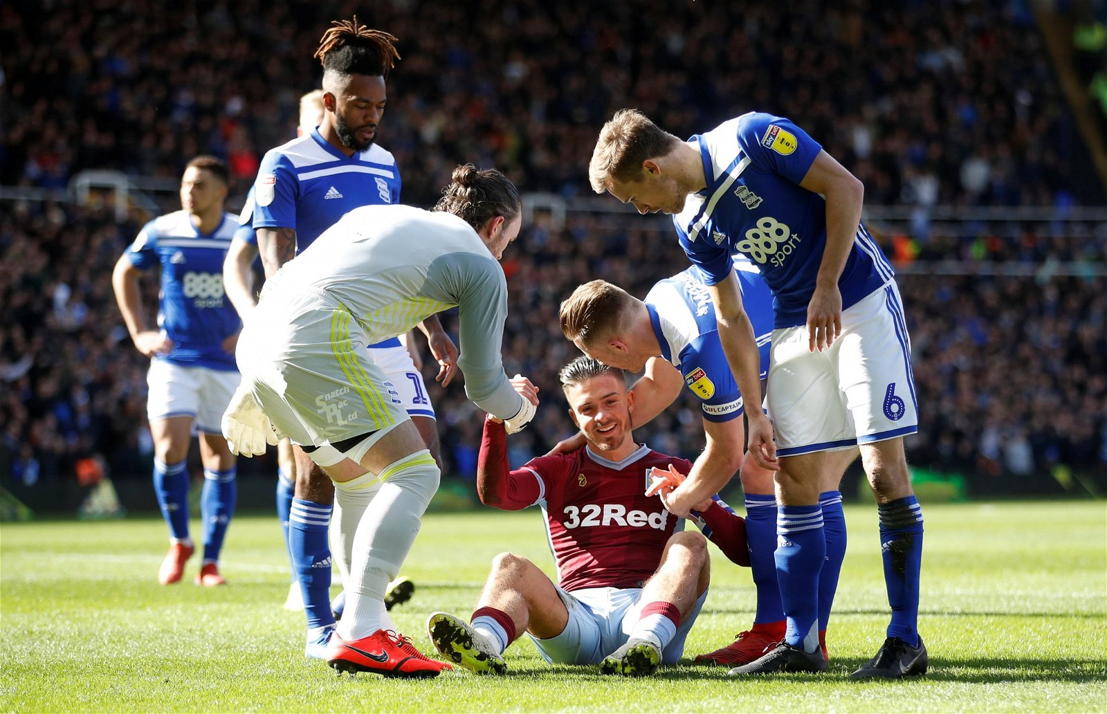 Birmingham City players check Aston Villa star Jack Grealish is ok after shock fan incident