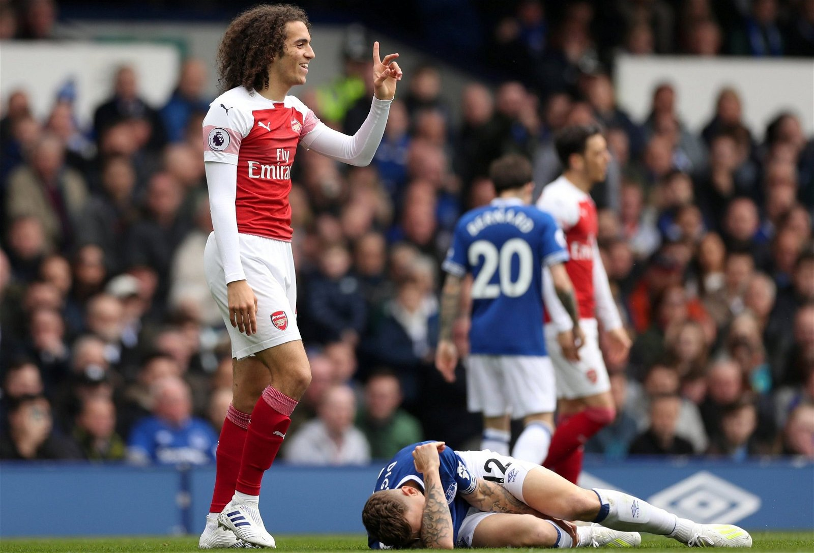 Arsenal midfielder Matteo Guendouzi reacts after being booked vs Everton