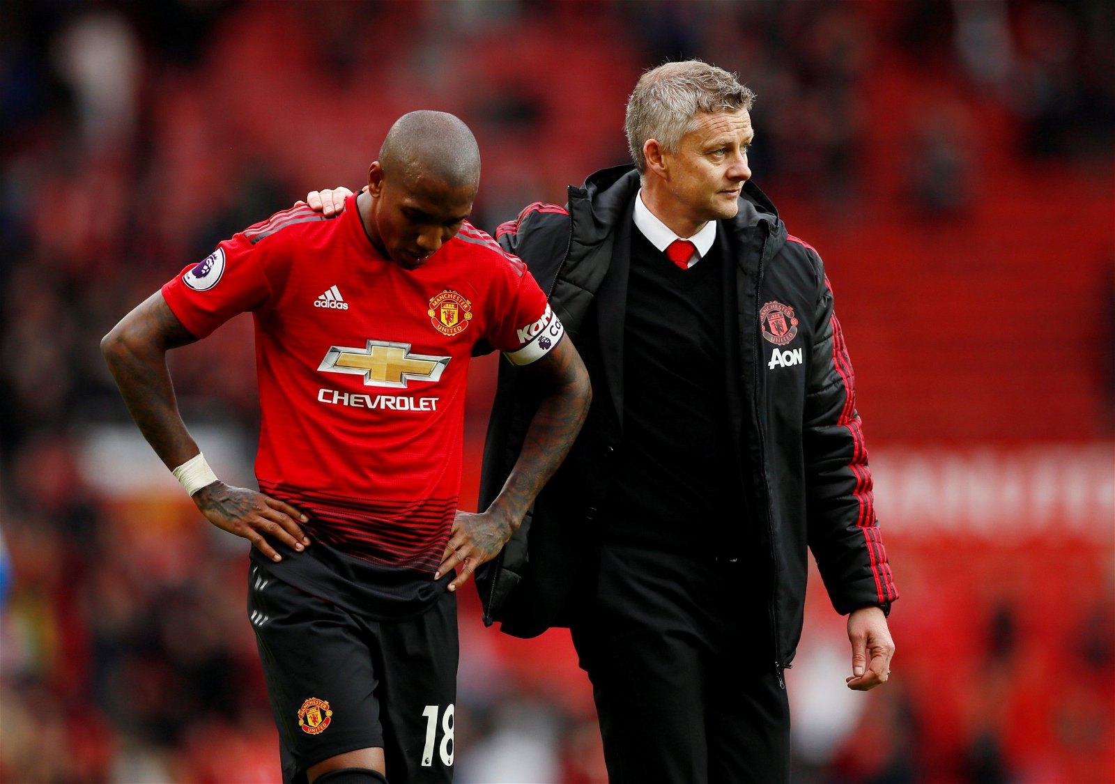 Manchester United manager Ole Gunnar Solskjaer consoles Ashley Young after draw vs Chelsea