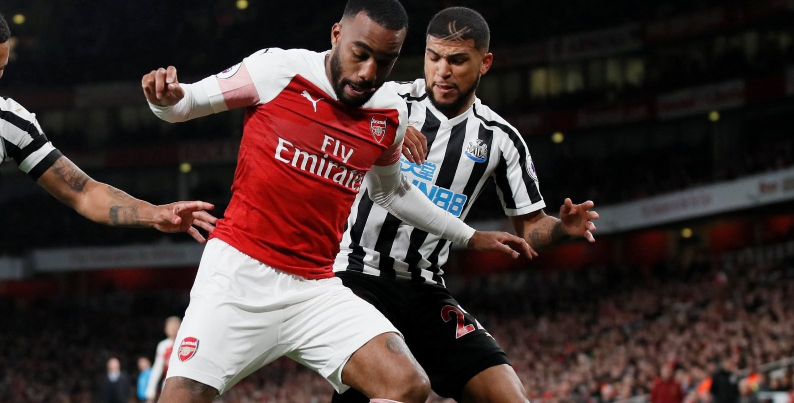 Newcastle defender DeAndre Yedlin battles with Arsenal striker Pierre-Emerick Aubameyang