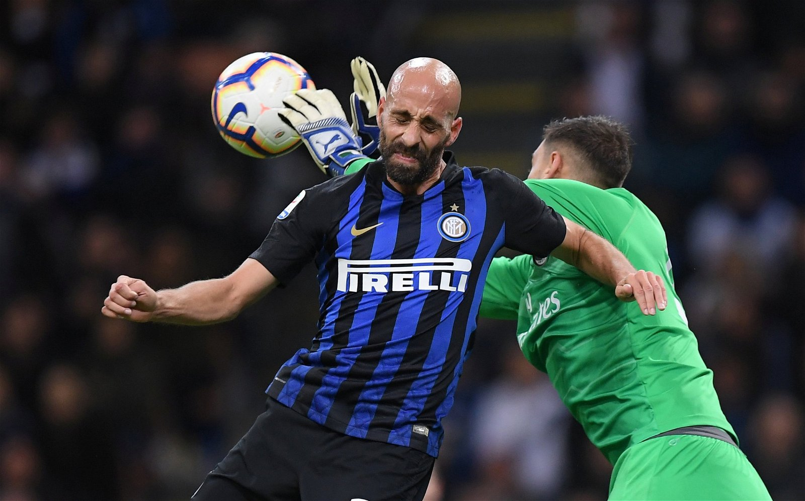 AC Milan goalkeeper Gianluigi Donnarumma punches the ball away vs Inter Milan - [Images] - The photos that indicate why Donnarumma would be a big Bernd Leno upgrade