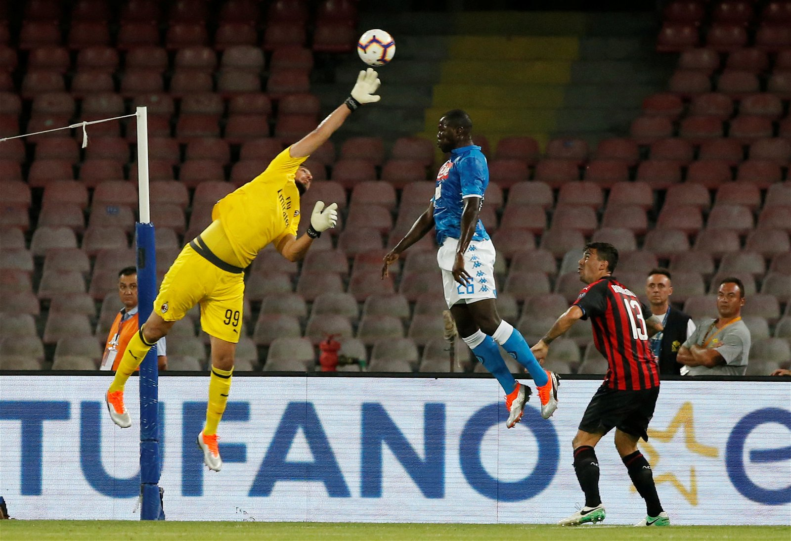AC Milan goalkeeper Gianluigi Donnarumma punches the ball away with Napolis Kalidou Koulibaly lurking - [Images] - The photos that indicate why Donnarumma would be a big Bernd Leno upgrade
