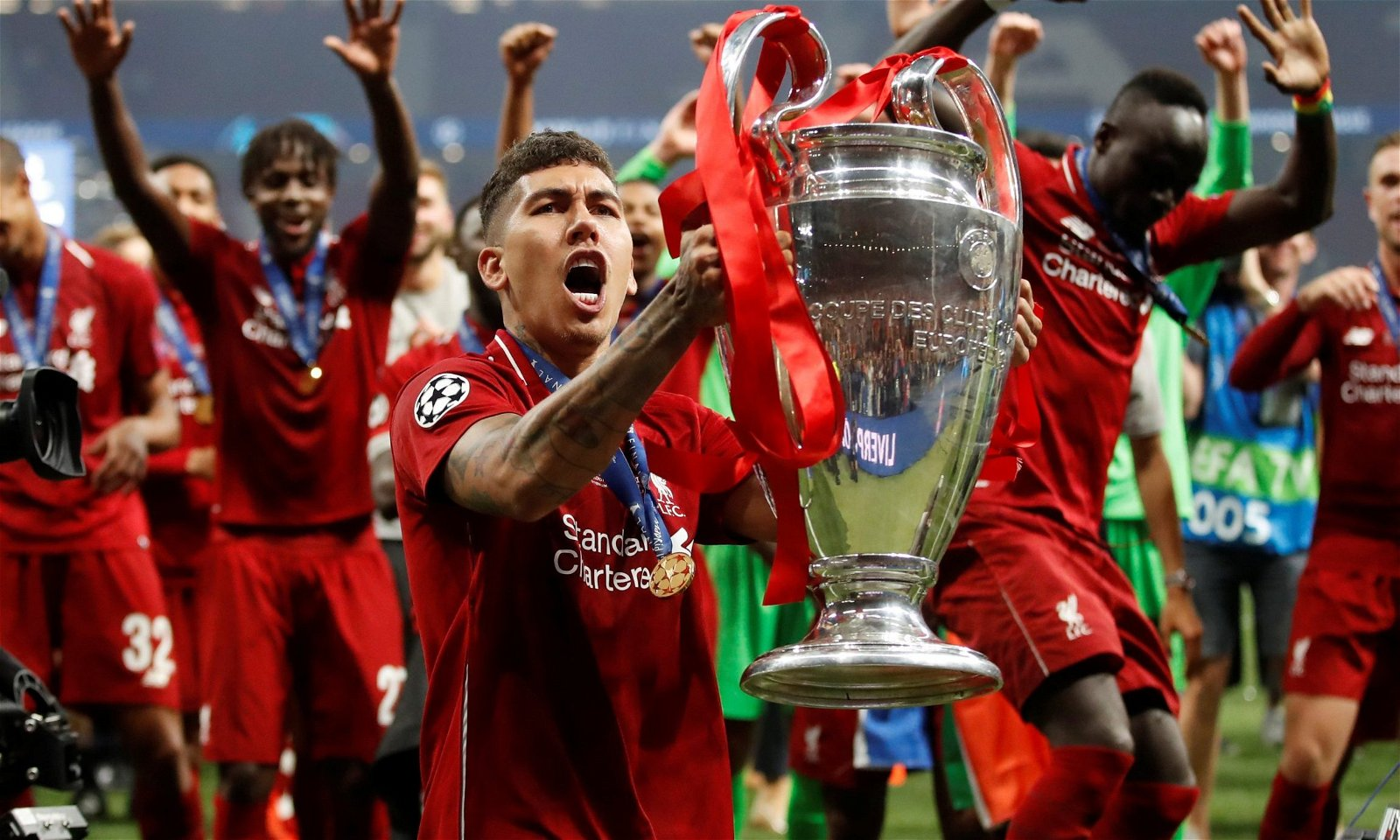Liverpool's Roberto Firmino shows off his new look at Champions ...