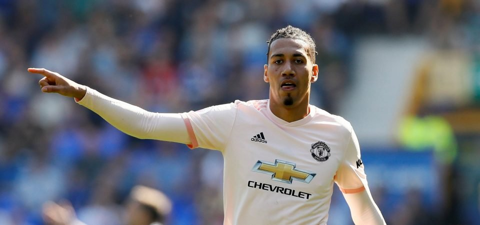 Manchester United players congratulate Chris Smalling on his first goal for new club