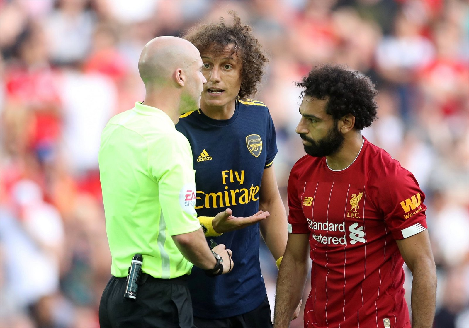 David Luiz gets a word from the referee - [Image] - The picture of David Luiz that perfectly sums up his evening at Anfield