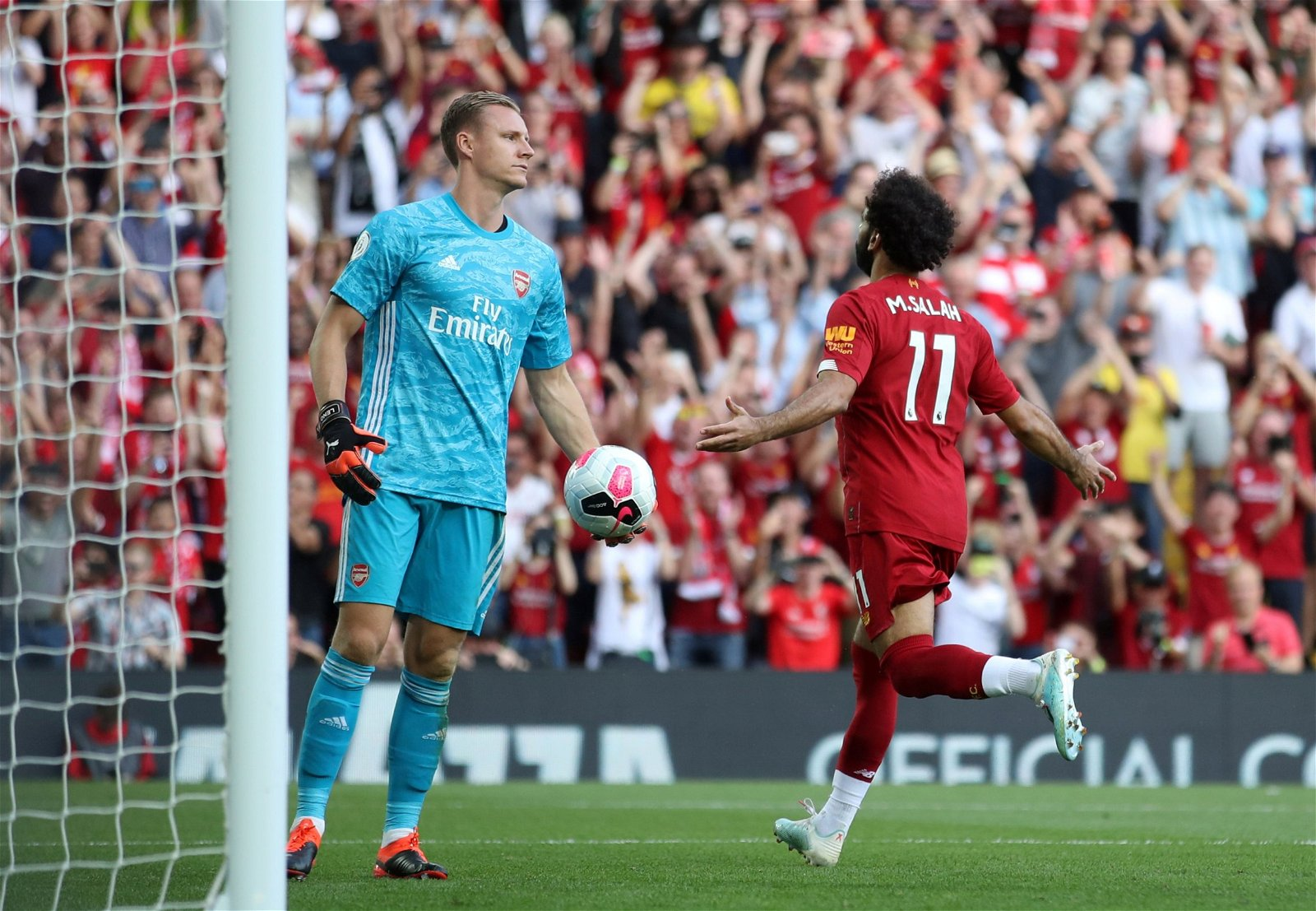 Salah celebrates after putting his second past Leno - [Image] - Liverpool's dominance perfectly captured by this picture of Mohamed Salah