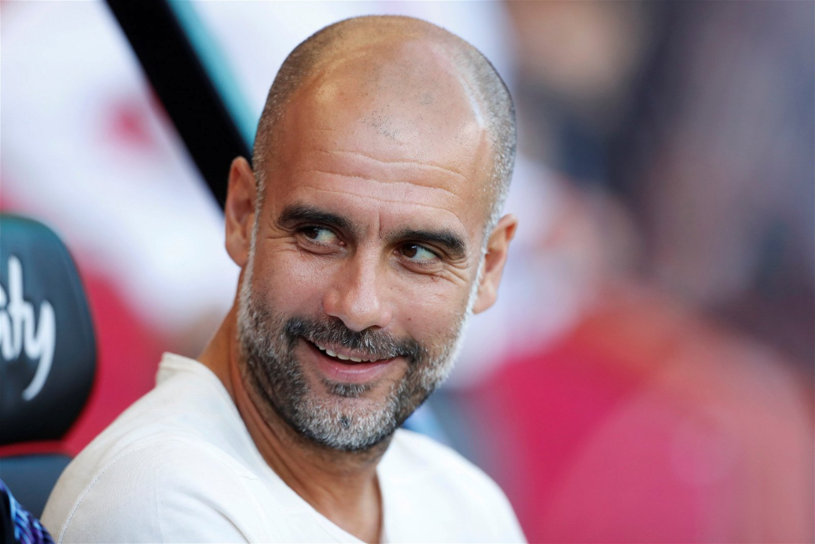 Pep Guardiola smiling before match against Bournemouth