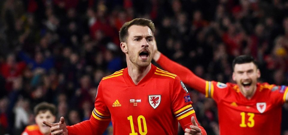 Arsenal fans react after Aaron Ramsey scores twice for Wales
