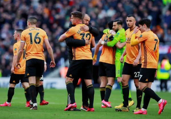 wolves players celebrate with manager nuno santo