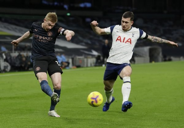 Manchester City's Kevin De Bruyne in action with Tottenham Hotspur's Pierre-Emile Hojbjerg