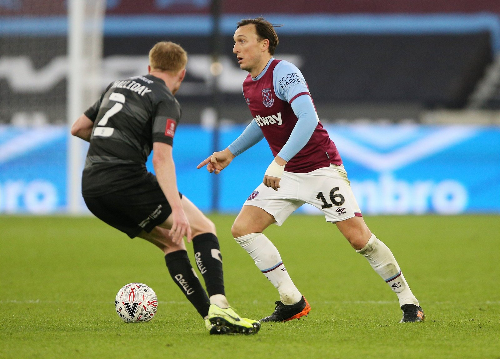 West-ham-uniteds-mark-noble-in-action-with-doncasters-bradley-halliday