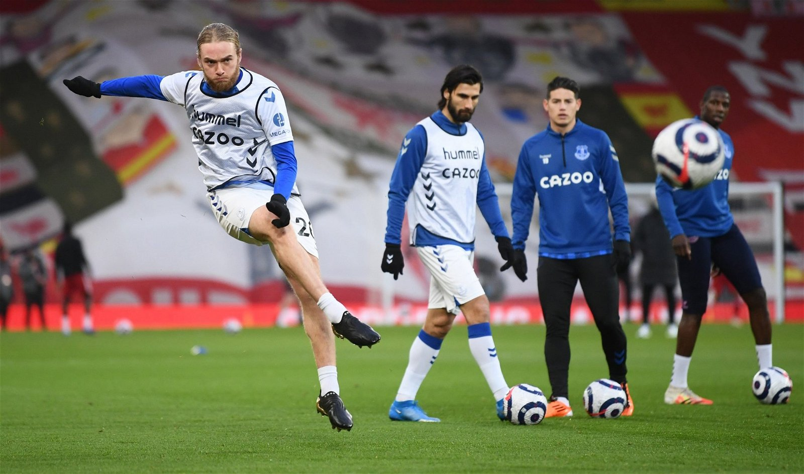 Evertons-tom-davies-during-the-warm-up-before-the-liverpool-match-e1614175261635